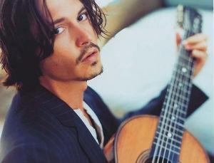 johnny-depp-johnny-depp-with-guitar-59818348941_xlarge
